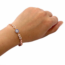 EVIL EYE ROSE COLORED INFINITY AND ROUND BRACELET